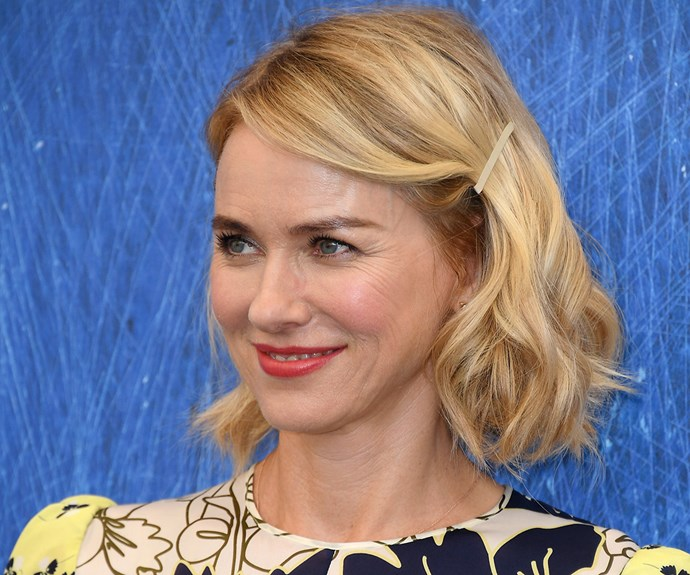 **Naomi Watts** knows the power of a good hair accessory - they're the fastest way to take your everyday strands from same-same to super glam. Pull your hair into a side part and then pop in a pretty hair slide. That's it! If you have time, you can put a curl through the ends of your hair using a straightener, but there's no real need. A hair accessory does all the hard work for you. Talk about effortless!