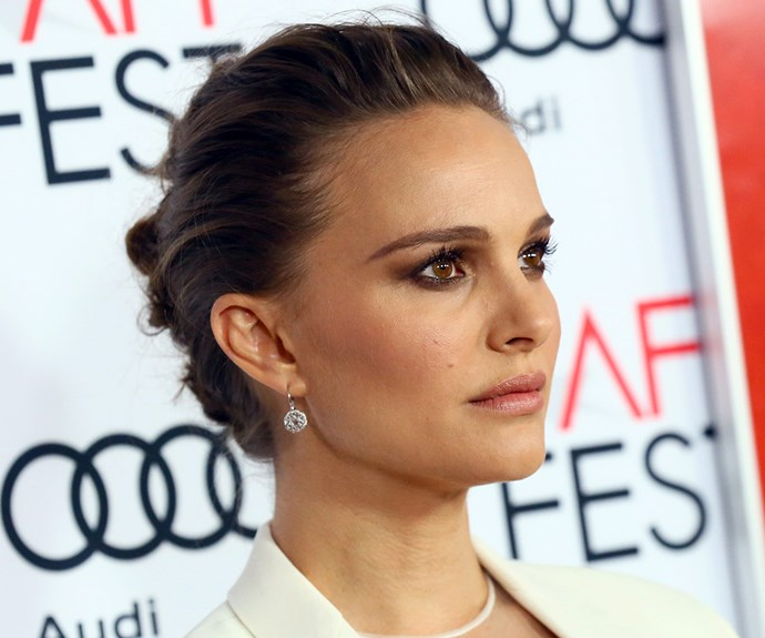 **Natalie Portman's** voluminous bun looks really elegant for day or night - and it's basically a polished version of your everyday hairstyle. Start by backcombing around your hairline using a bristle brush or comb, then gently pull your hair back into a bun being careful not to squash the volume you've just created. Pin your bun in place and use your fingers to gently boost the hairline volume a little more. Tip: if you've got freshly-washed hair, use a little dry shampoo before you backcomb for added added oomph.