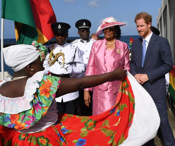 Prince Harry joined Governor General Cecile la Grenade as they greet local dancers at Grenada Cruise Port.