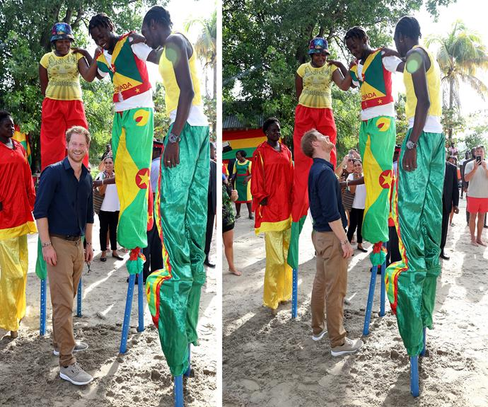 The charming royal had a new royal high while at Grand Anse Beach, where he was greeted by stilt walkers.