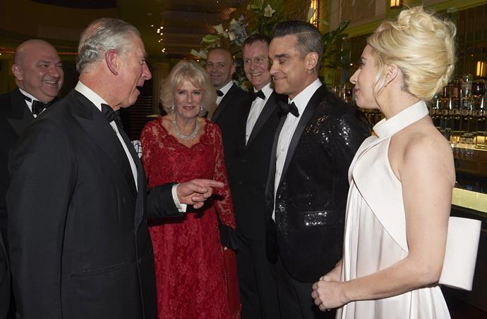 Prince Charles shares a joke with Robbie Williams.