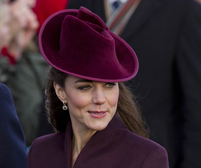 Kate looked stunning in a burgundy coat and matching hat.