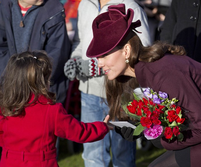 Meeting the crowds: Catherine accepts some flowers from a young girl.