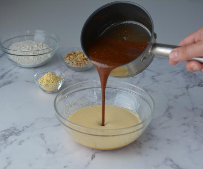Add cooled chocolate and butter mixture into egg mix.