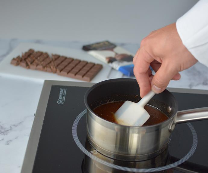 Gently melt butter and chocolate together until just molten, remove from heat and set aside to cool.