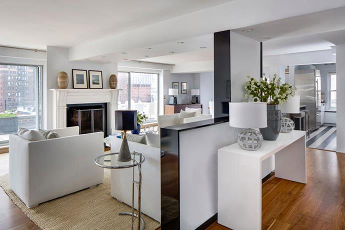 Neutral tones and a majority white colour palette make the home look even more spacious than it is. *Image via [Zillow](http://www.zillow.com/)*