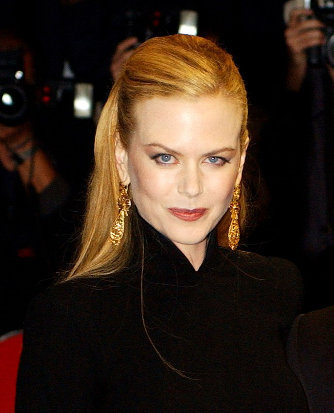 At the 2001 London premiere of *Moulin Rogue!* Nicole brushed her long locks back to highlight her defined cheekbones. After splitting with husband Tom Cruise earlier that year, she returned to her roots quite literally, going back to her signature red.