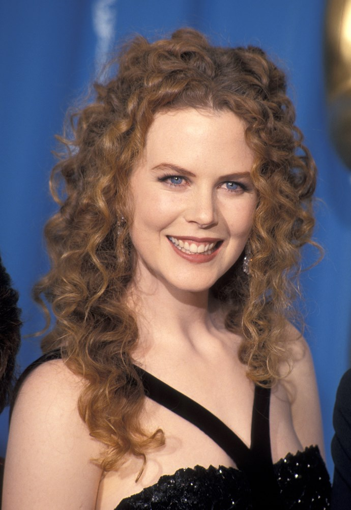 While attending the 66th Academy Awards the following year, the 49-year-old had totally tamed her trademark corkscrew curls and made a strong case for the classic 90s terracotta brown lipstick.