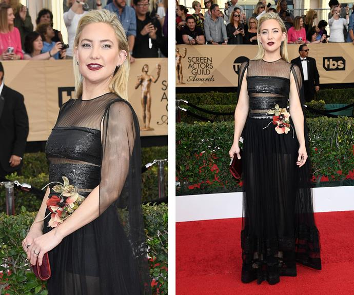 Kate Hudson's vampy lip complements her black gown.