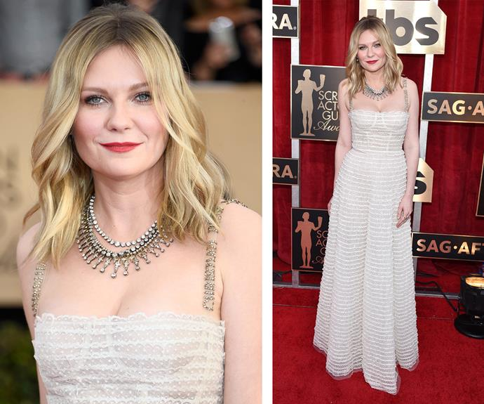 Kirsten Dunst wears a subtle, ivory gown to support her *Hidden Figures* co-stars.