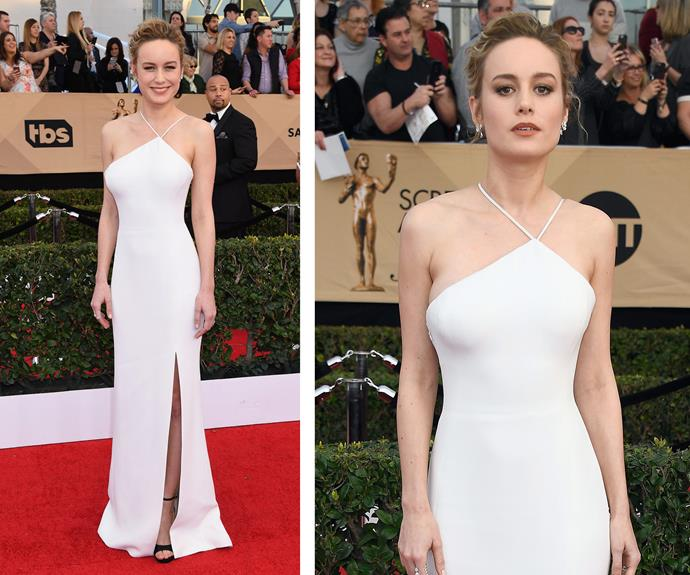 2016 winner Brie Larson wore an asymmetrical, white dress for her appearance on the red carpet.