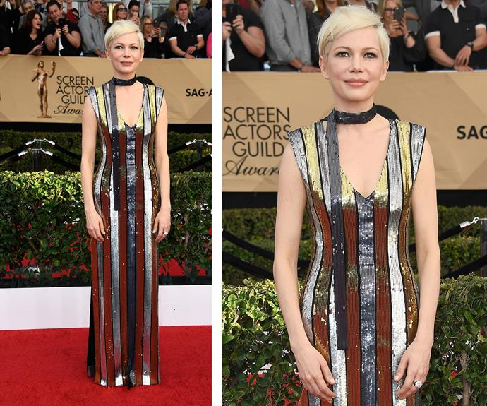 Michelle Williams shines in a striped Louis Vuitton dress.