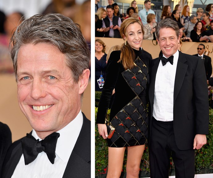 A dashing Hugh Grant is photographed with partner Anna Elisabet Eberstein.