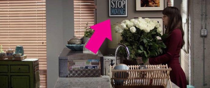 "**12.** The sign in Ana's kitchen that says, ""STOP MOVING."" Maybe it also says ""DON'T"" and it's just cut out of the frame, but it's a lot more fun to imagine that Ana is so high-strung that she needs a kitchen sign to remind her to breathe."