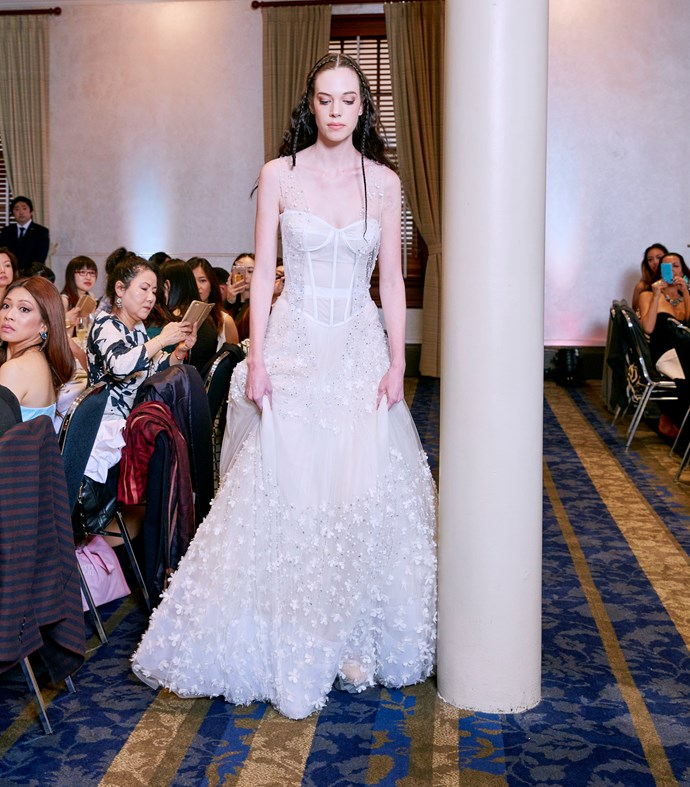 **The Romanticist Bride** Your decisions are directed by passion and a wedding gown represents fantasy to you. You are about looking feminine details and billowing tulle. The Viola gown is the one for you with its corset and sewn crystal details.