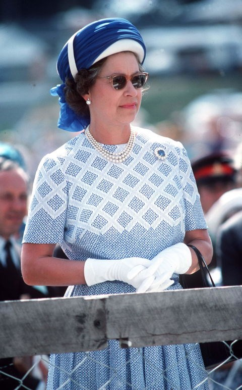 **Queen Elizabeth, 1977** When we saw this picture of the Queen rocking a cool turban-inspired hat and sunglasses it made our life.
