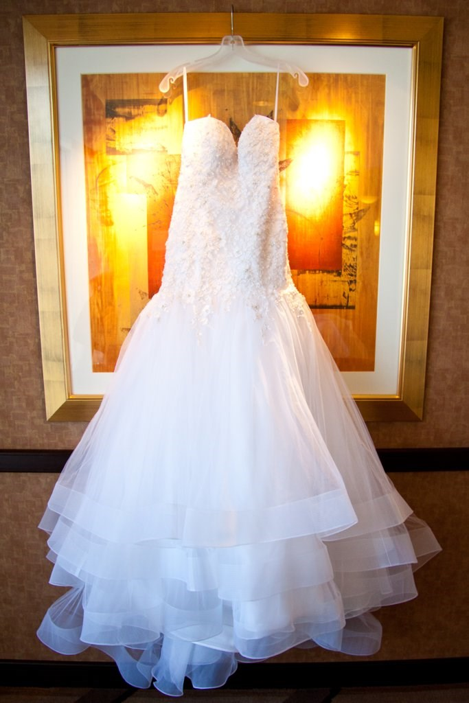 While Ashley's dress might *look* like like a classic bridal gown, it's actually designed by Alfred Angelo for Disney Weddings. As you'll soon these, these guys don't do things in halves.
