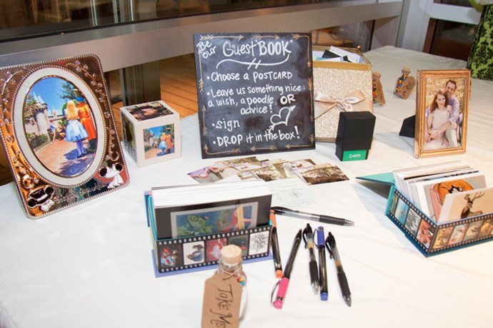 The guest table was decked out with Disney postcards for the guests to write a note for the lovebirds.