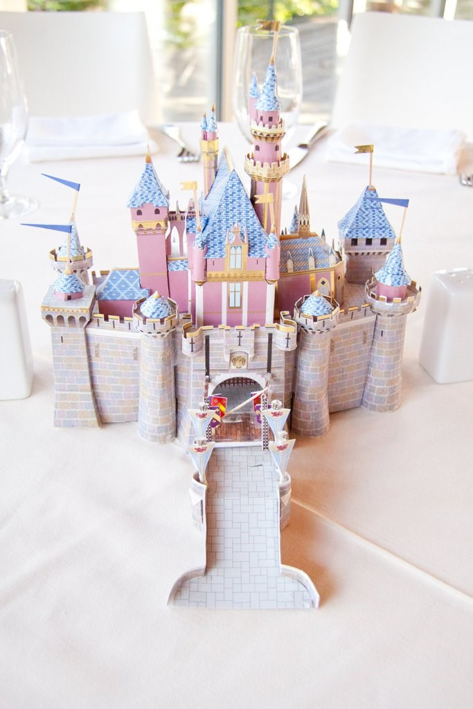 Aaaaaaand then there were the table decorations. Rather than going for your standard bouquet of peonies Ashley and Ty decided to go all-out and gave each table a different Disney movie theme <33. In case you hadn't already figured this one out, it's *Sleeping Beauty*'s grand AF castle.