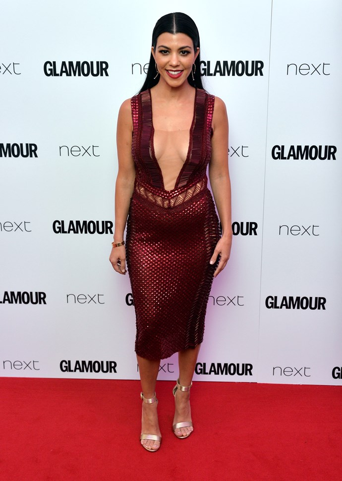 Hot *DAYUM* - Kourtney amps up the sexy factor in this plunging crimson number.