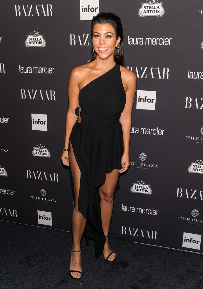 Low and behold: Kourtney K looks as fire as ever in this double-split LBD. All hail, Kween K!