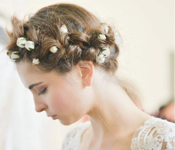 You could put accessoriSe your half-up, half-down hairstyle with a half-moon crown, or dot small flowers throughout a crown braid.