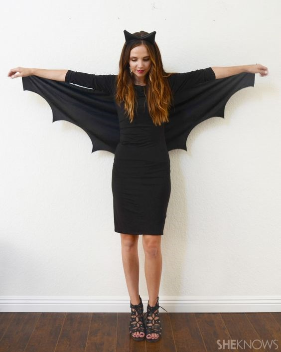 """**7. Batgirl** Grab your fave LBD and a piece of black cloth (or even a tee you don't like anymore) and cut out some wings. Attach the wings to the back of your dress with safety pins  and you're party ready. Finish with an ear headband. Via [Pinterest](https://au.pinterest.com/pin/135389532528009563/ target=""""_blank"""")"""