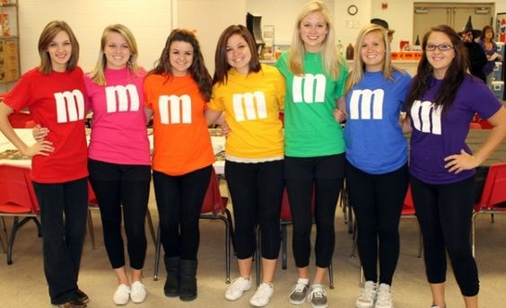 """**3. M&Ms** It doesn't matter how many peeps there are in your squad, simply find one of your bright tees, cut out a white 'M' and stick it on the middle and voilà! You're one delish looking M&M. Via [Pinterest](https://au.pinterest.com/pin/328833210276743025/ target=""""_blank"""")"""