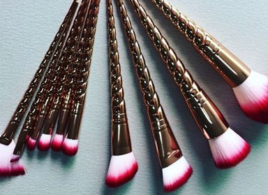 These rose gold unicorn makeup brushes are the sh*t dreams are made of