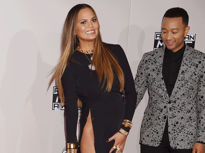 Chrissy Teigen claps back at fans that shamed her high-slit AMAs dress