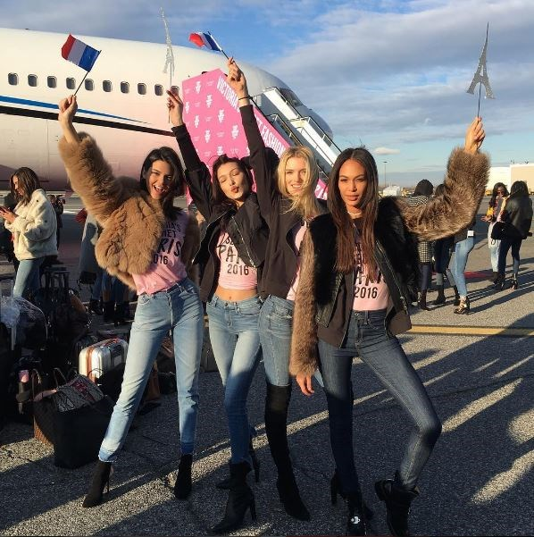 Kendall Jenner, Bella Hadid, Lily Donaldson and Joan Smalls on the tarmac looking hot AF.