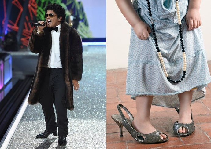 **15. A small child playing dress up in heels** In other musical performers, Bruno's so cute and itty bitty compared to the models. I mean, that fur coat would be, like, a fur crop top for them.