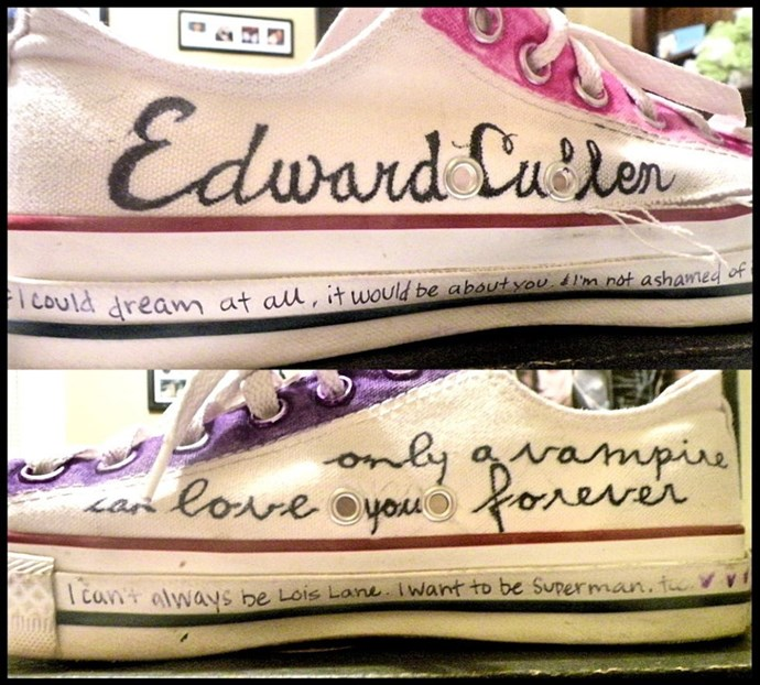 **Customised Converse Sneakers**  And I don't mean like, custom-made. I mean that you customised them yourself by drawing and writing shit all over them, like this enterprising young person did to declare a deep love for Edward Cullen.
