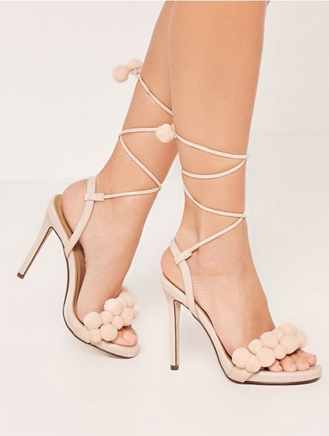 "Nude Pom Pom sandals, $33 from [Missguided](https://www.missguidedau.com/pom-pom-detail-wrap-around-heeled-sandals-nude|target=""_blank"")."