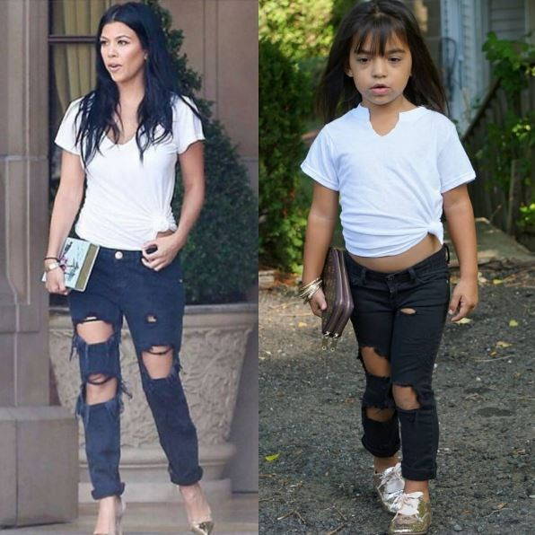 Clutch? Check. Ripped black skinny jeans? Yep. Plain white tee? Omg yes. Here Sofia is totally owning this Kourtney Kardashian-inspired look.