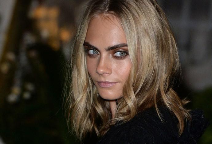 **DARK BLONDE**   Cara Delevingne's features stand out against her ashy dark-blonde hair.