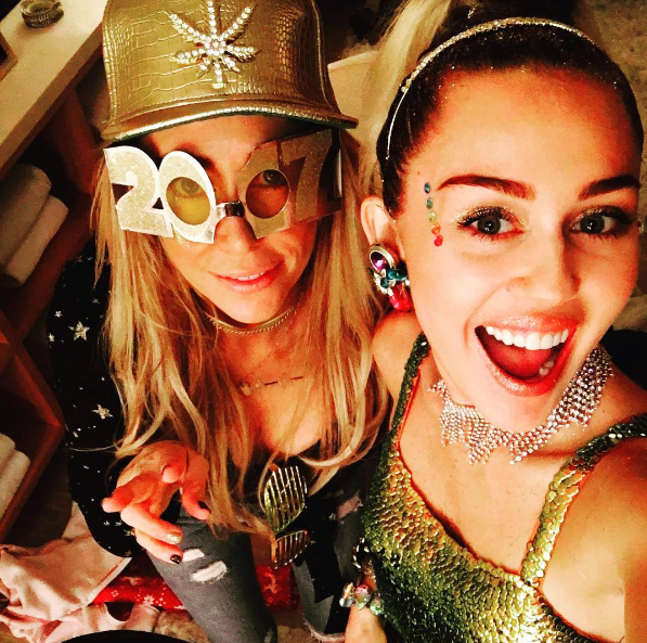 Miley's mum, Tish Cyrus, was also at the party wearing some snazzy looking get-up.