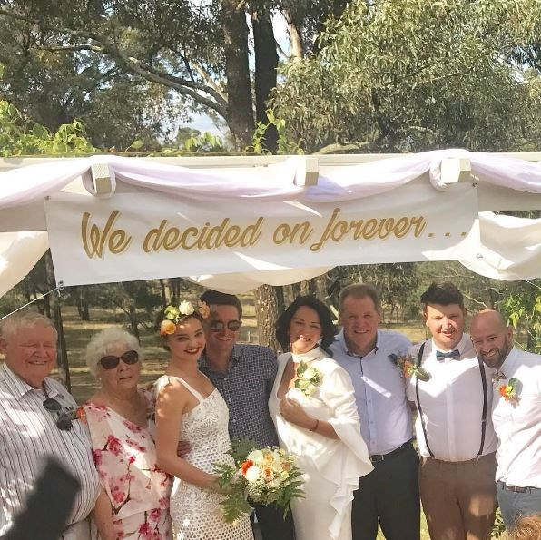 Miranda Kerr and mumma bear Therese stepped out in gorgeous ivory gowns for her brother's wedding over the weekend and we DIE.