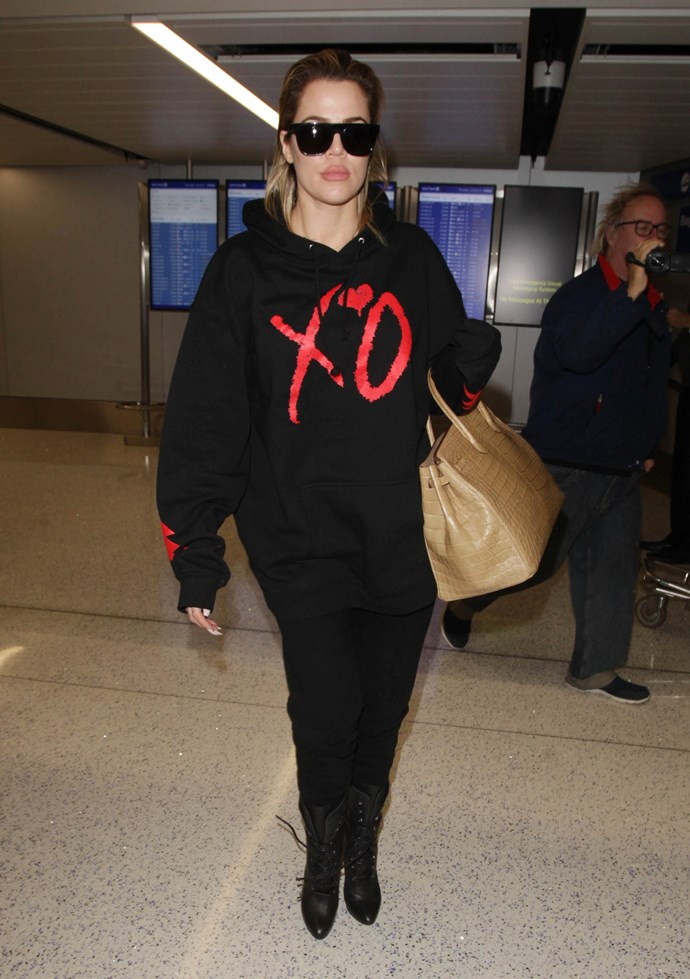 Khloé Kardashian masters the art of airport style, reppin' the comfy yet chic hoodie of your dreams.