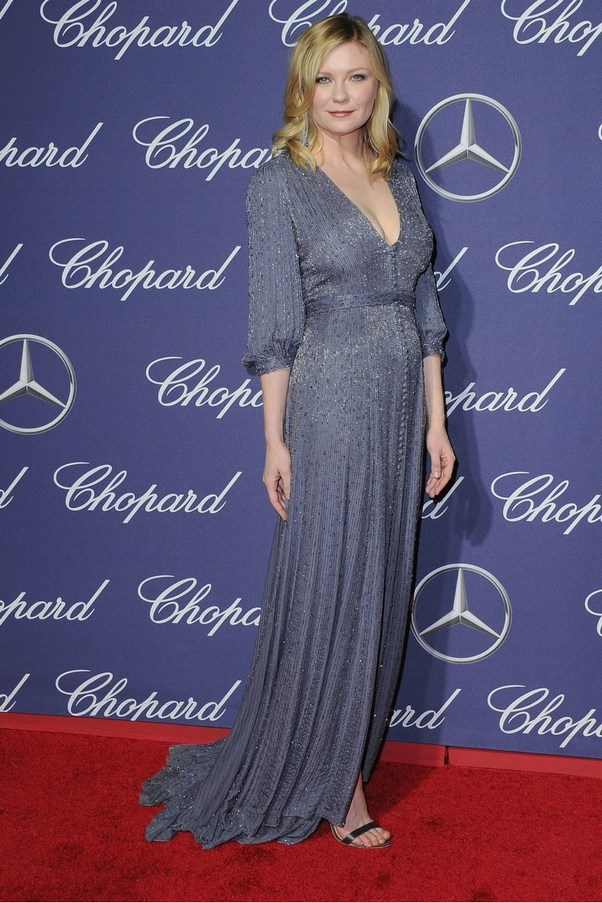 Kristen Dunst steps out at the Palm Spring Film Festival wearing this hella elegant violet gown.