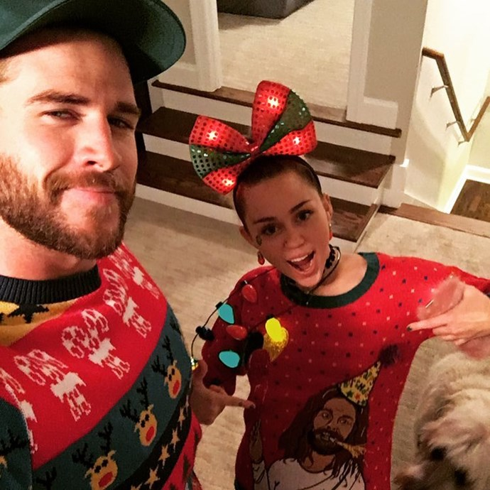 Matching ugly Christmas sweaters (our hearts).