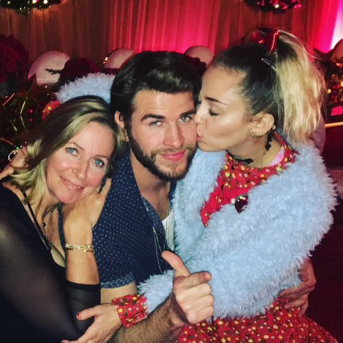 Liam sandwiched between his two favourite women at Christmas.