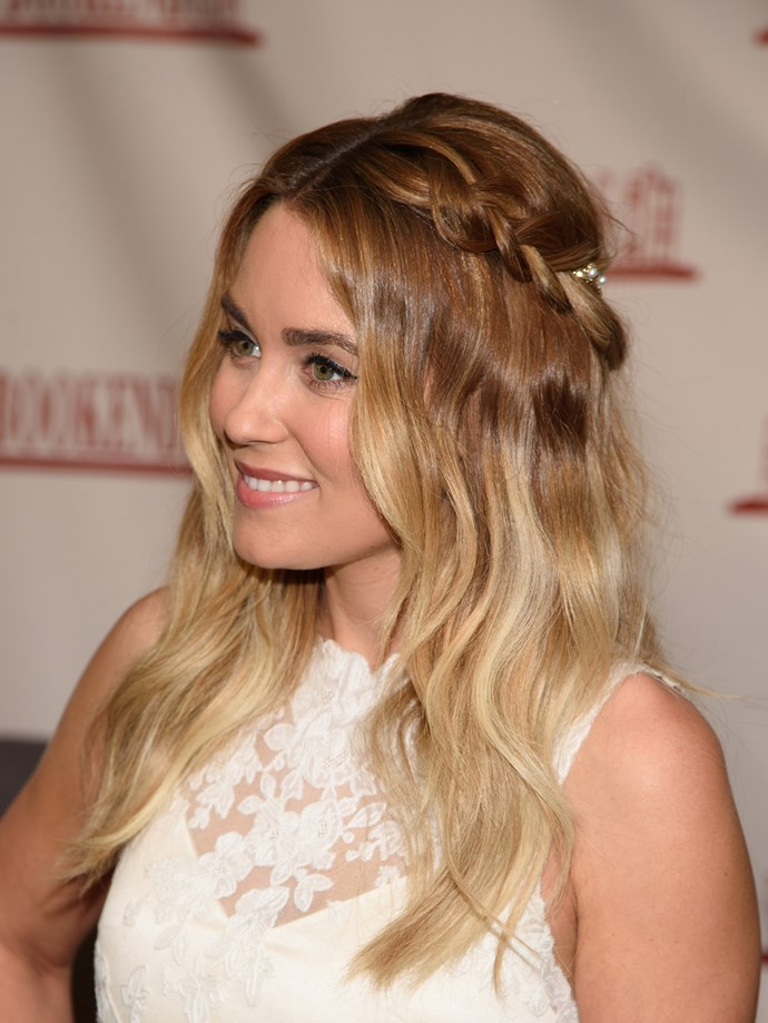 At the launch of her new book 'Lauren Conrad Celebrate' in March last year, she went for a pushed-back halo plait with textured waves, pinned in place with a pearl hair accessory. Cahute!