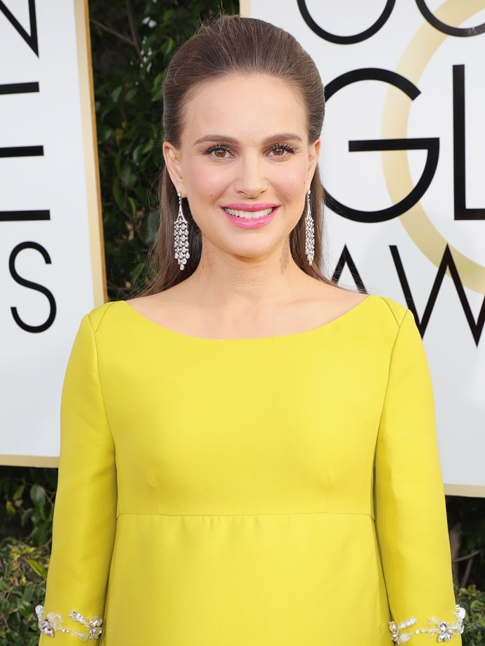 Natalie Portman's pushed back 'do gives us a full view of her chandelier earrings.