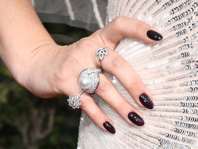 **Drew Barrymore** <br>  Drew's workin' glossy almond shaped nails in our favourite shade of deep mahogany.
