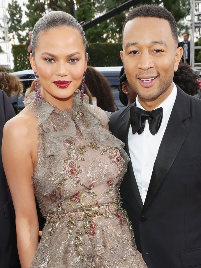 Everybody's *other* favourite couple, Chrissy Teigen and John Legend were also there! Teigen's hair was slicked back, drawing attention to her bold red lip. J'adore!