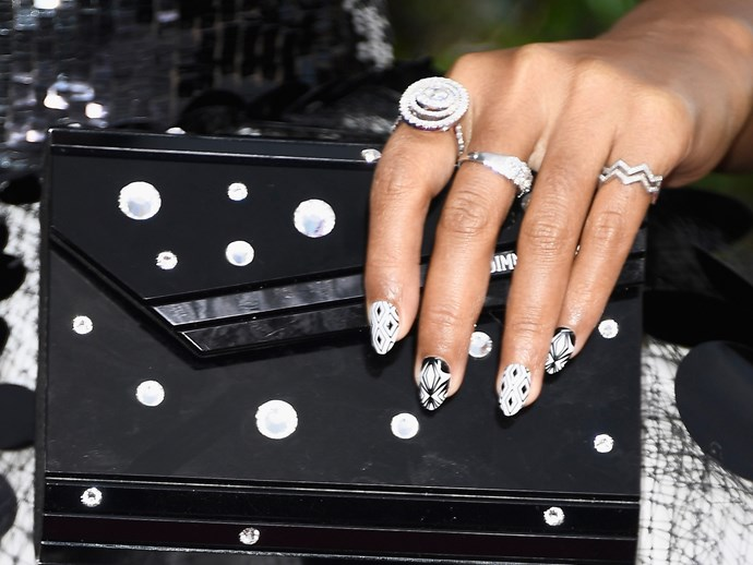 **Janelle Monae** <br>  These graphic nail stickers prove print on print can really work.