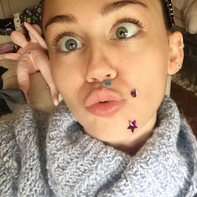 "**Miley Cyrus:** And this, ""Is this to obvious that I'm trying to hide something ..... #newyearspimples"""