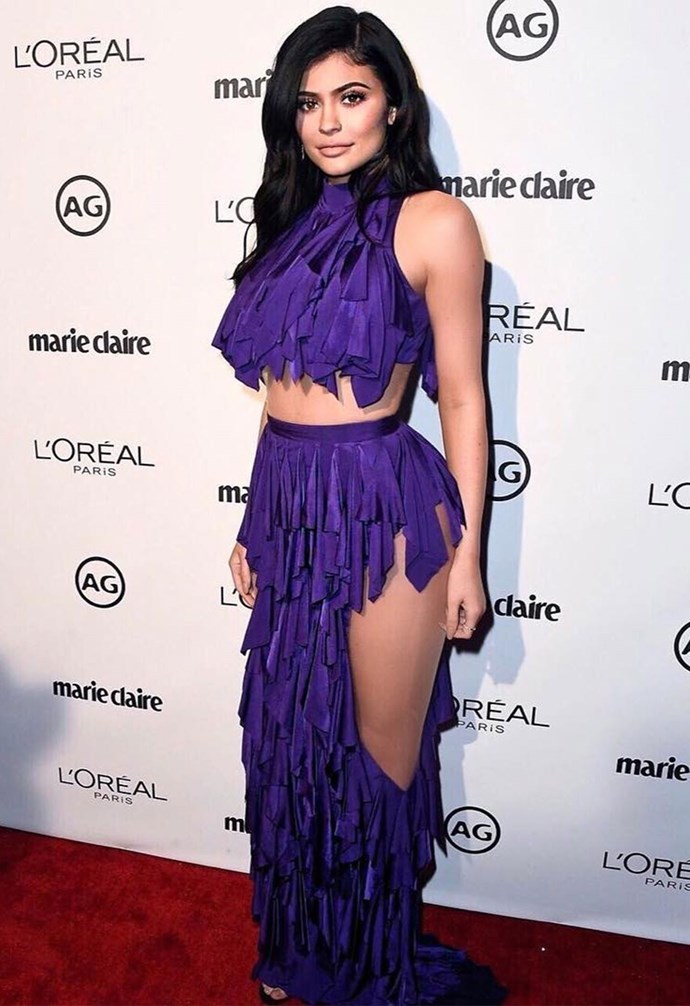 Kylie Jenner just stepped out in one of her craziest looks yet in this two-piece, purple ruffle Balmain number. Can we just take a second to talk about the ginormous cut-outs in the skirts? Yep. We love you Ky, but it's a 'no' from us on this one, soz.
