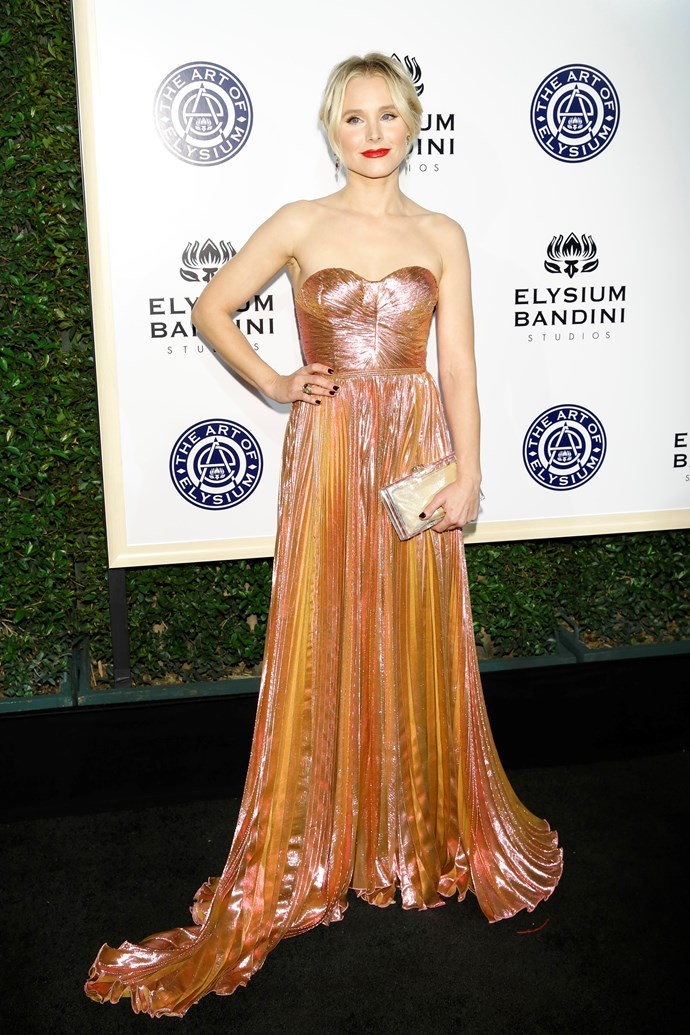 Kristen Bell dropped jaws at the Art of Elysium charity gala wearing a TDF metallic apricot gown.